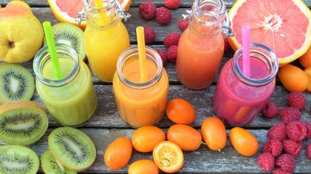 Colourful selection of fruits and juices