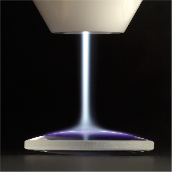 Interfacial modification of an artificial stem cell niche using CAP. Image was taken when using a handheld plasma device based on piezoelectric direct discharge (PDD) technology. The gaseous plasma jet can be seen exiting the nozzle and spreading over the target surface
