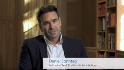 Still image from one of the videos, showing the editor-in-chief Daniel Sonntag speaking.