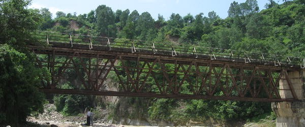 Time–frequency and wavelet-based study of an old steel truss