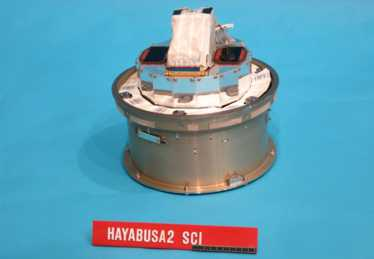 The Small Carry-on Impactor (SCI) and the Hayabusa2 Impact