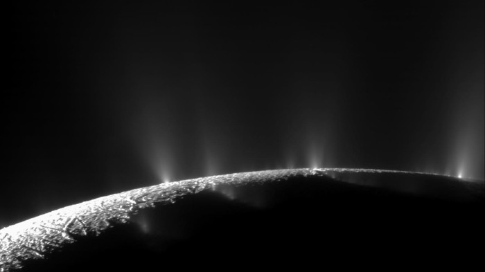 Geysers shoot out from the surface of Enceladus, one of Saturn's moons.